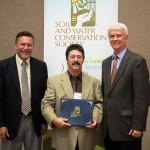 Mike Morris, center, accepts the Commendation Award at the 2015 SWCS International Conference